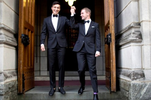 West Point graduate Larry Lennox-Choate, left, and Daniel Lennox-Choate, leave church following their wedding ceremony on Saturday, Nov. 2, 2013, at the U.S. Military Academy's Cadet Chapel in West Point, N.Y. Choate and Lennox are the first men to wed at the chapel since New York legalized gay marriage in 2012. The chapel has already hosted two same-sex weddings of women in late 2012. (AP Photo/Jill Knight) NO SALES, MAGS OUT
